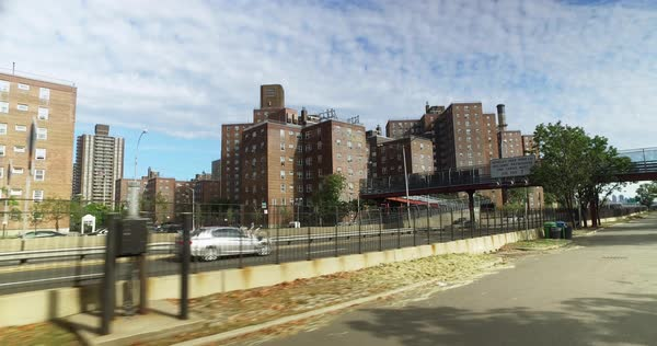 Riding a bike past the apartment buildings in the Alphabet City neighborhood of Manhattan.  	 Royalty-free stock video