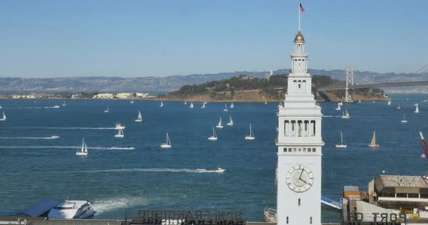 A high angle daytime establishing shot of the Ferry Building Clock Tower and boats in San Francisco Bay. Royalty-free stock video