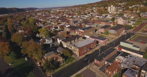 A slowly moving forward aerial shot of a typical Western Pennsylvania small town in the Autumn. Pittsburgh suburb.	 	 Royalty-free stock video