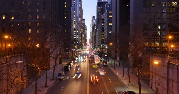 NEW YORK CITY - December, 2016 - A night timelapse establishing shot of the busy activity on 42nd Street as seen from the Tudor City Bridge.  	 Royalty-free stock video