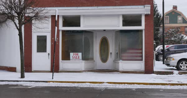 A wintry establishing shot of an empty storefront in a small town Royalty-free stock video