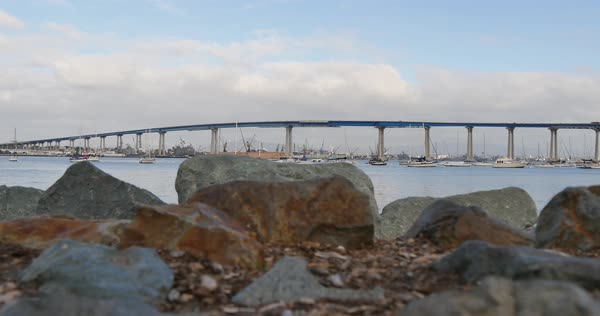 A low angle slow dolly establishing shot of Coronado Bridge between San Diego and Coronado Island.  	 Royalty-free stock video
