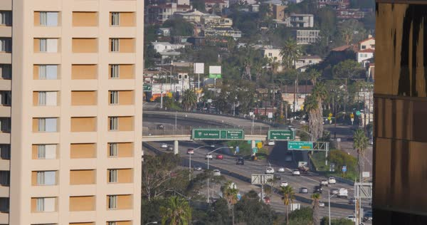 A long establishing shot of traffic on Interstate 5 in downtown San Diego.  	 Royalty-free stock video