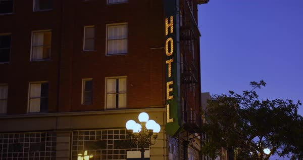 A nighttime establishing shot of a typical hotel in a large city.  	 Royalty-free stock video
