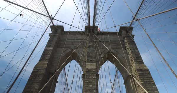Looking up at one of the pillars of the Brooklyn Bridge on a summer day.  Royalty-free stock video