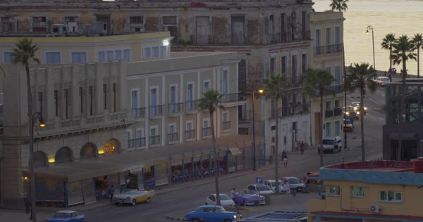 A high angle stationary establishing shot of traffic and pedestrian activity along the shoreline of Havana, Cuba. Royalty-free stock video