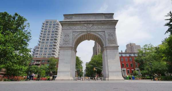 NEW YORK CITY - Circa June, 2015 - A timelapse establishing shot of Washington Square Arch in Washington Square Park in Manhattan. Royalty-free stock video