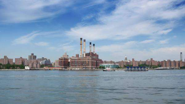 NEW YORK CITY, Circa June, 2015 - A daytime view of the skyline of Manhattan with the Con Edison power plant visible in the foreground. Royalty-free stock video