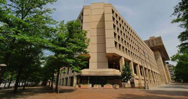 A daytime establishing shot of the FBI Building in Washington, D.C. Royalty-free stock video