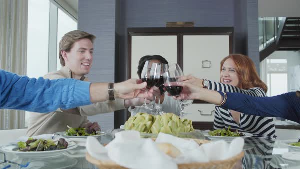 Medium shot of people toasting at a dining table Royalty-free stock video