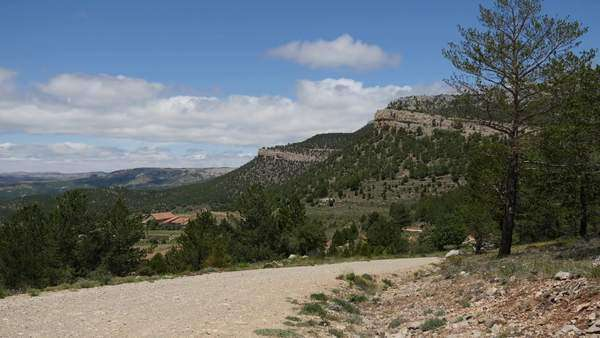 A dirt road leads down slope in a remote part of the Sierra de Guidar. Royalty-free stock video