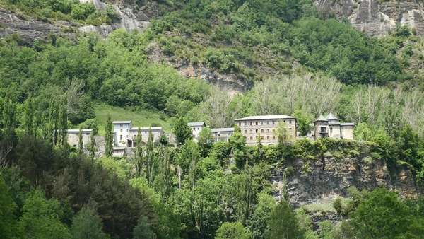 Houses of a village stretch out on a ridge in the Pyrenees. Royalty-free stock video