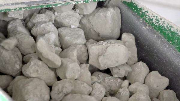 Big limestone rocks on a stone conveyor in a factory stock footage