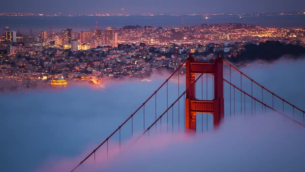 Timelapse nighttime Golden Gate Bridge close-up with fog. Rights-managed stock video