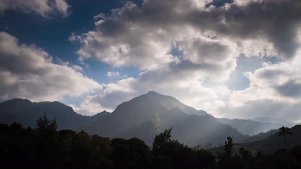 Sunset island mountains, sunset light rays, hawaii timelapse.  Rights-managed stock video