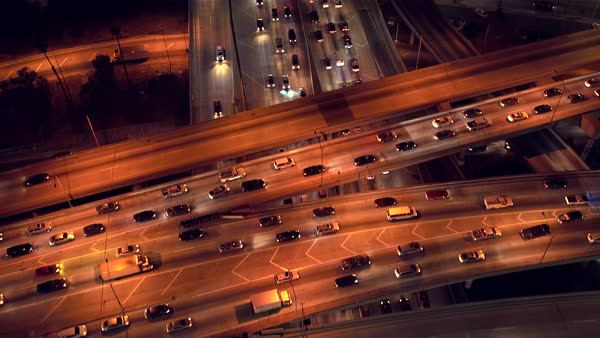 Downtown Los Angeles busy freeway junction traffic aerial, taken at night. Rights-managed stock video
