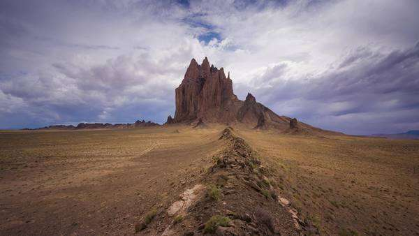 Timelapse static shot of Shiprock New Mexico with clouds. Rights-managed stock video