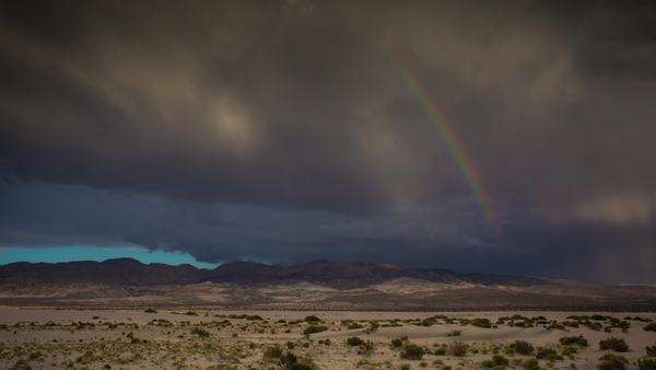 Timelapse static shot of Death Valley Rainbow stormy sunset. Rights-managed stock video