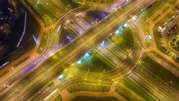 Night illumination city road junction circle traffic aerial panorama Royalty-free stock video