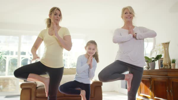 3 Female generations of family doing yoga workout together at home. Royalty-free stock video