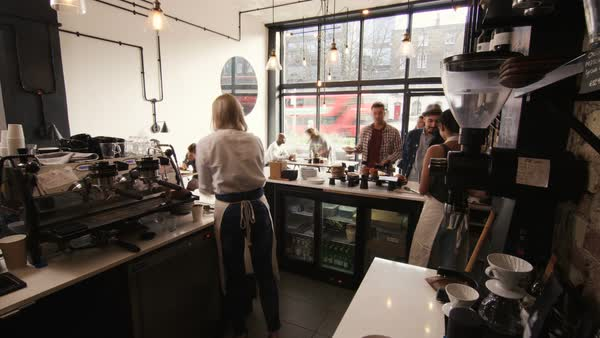 Timelapse of busy staff members serving customers in city coffee shop. Royalty-free stock video