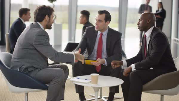 Male corporate business team in negotiation in busy modern office Royalty-free stock video