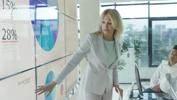 Woman giving presentation to colleagues in modern glass office Royalty-free stock video