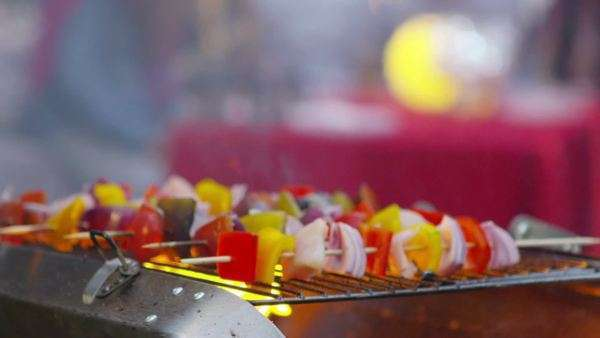 Close up on vegetable kebabs cooking on a bbq. Royalty-free stock video