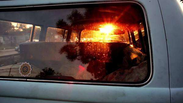 Sunset rays peaking through the back window of a VW Bus Royalty-free stock video
