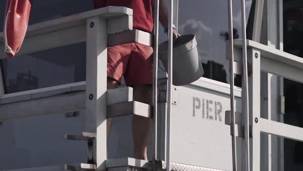 Close-up shot of lifeguard putting a life buoy to rest in watch tower Royalty-free stock video