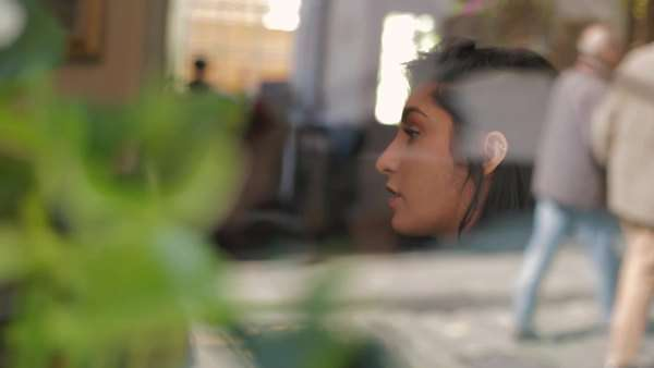 Medium close-up shot of young woman sitting in a cafe Royalty-free stock video