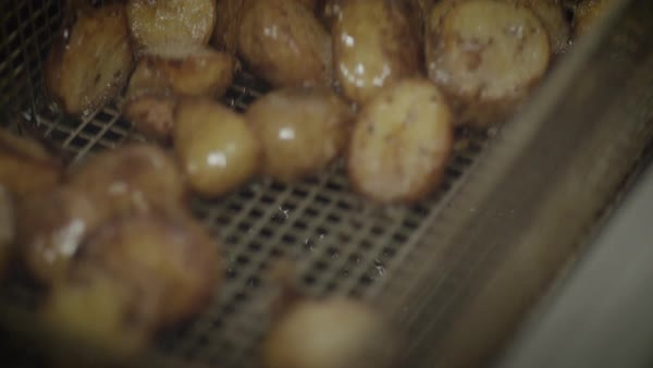 Hand-held shot of potatoes in a deep-fryer Royalty-free stock video