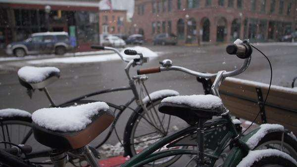 Medium shot of bikes in the snowfall Royalty-free stock video