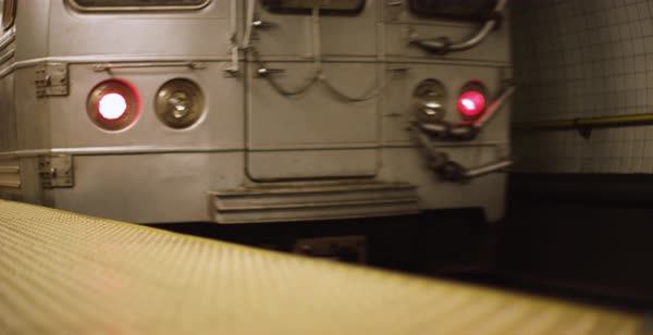 Panning shot of a subway car leaving a station Royalty-free stock video