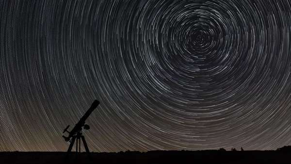 Star trails telescope astronomy stunning cosmos Polaris North Star at center as earth rotates on axis. beautiful star trails stunning cosmos. beautiful night sky Royalty-free stock video