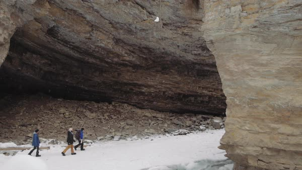 Wide-angle shot of hikers walking in Johnston Canyon Royalty-free stock video