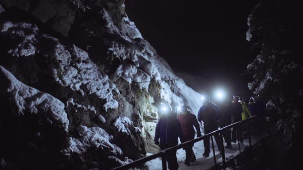 Wide-angle shot of people hiking at night in Johnston Canyon Royalty-free stock video