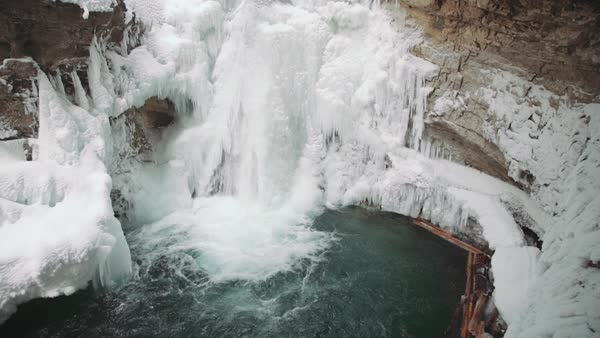 Wide-angle shot of a waterfall in Johnston Canyon Royalty-free stock video
