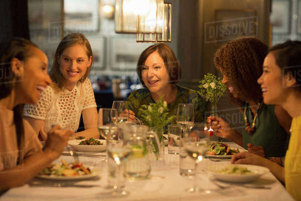 Smiling Women Friends Dining At Restaurant Table Stock