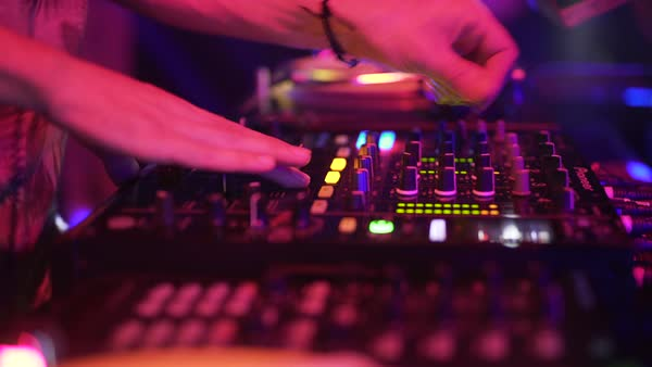 Hand-held shot of a disc jockey performing live Royalty-free stock video