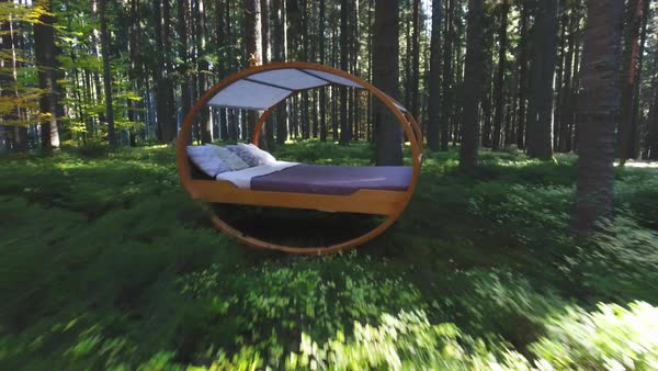Drone shot of a canopy swing bed in a forest Royalty-free stock video