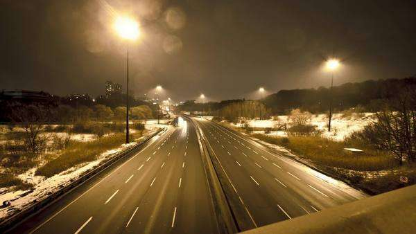 Motion timelapse of a highway with cars driving by shot from atop of a bridge during a cold and wet evening Royalty-free stock video