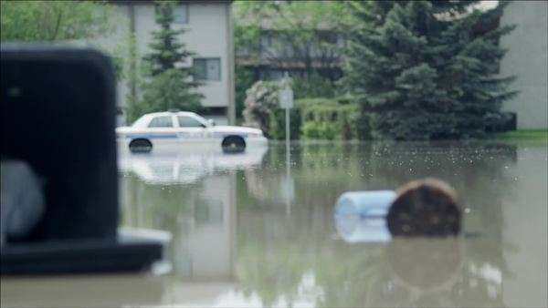 Police car stranded in flooded street Royalty-free stock video