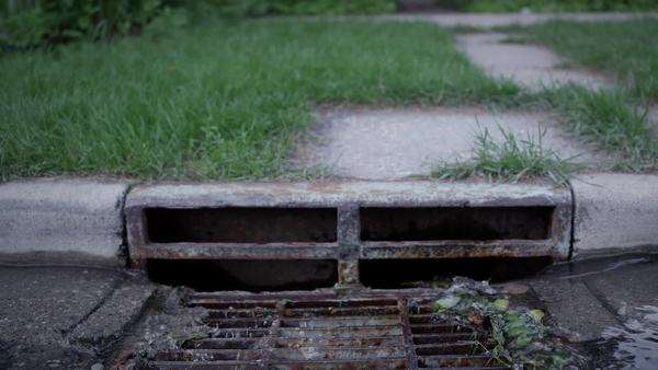 Storm drain with flood water pouring in Royalty-free stock video