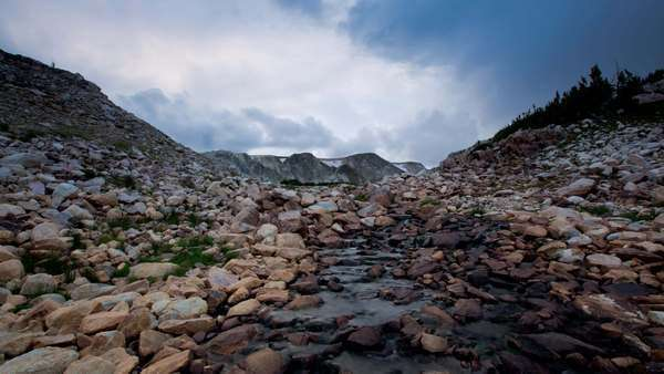 Sunset motion control timelapse tracking across small creek with mountains in the background Captured in the Snowy Range Mountains, Wyoming near South Gap Lake Royalty-free stock video