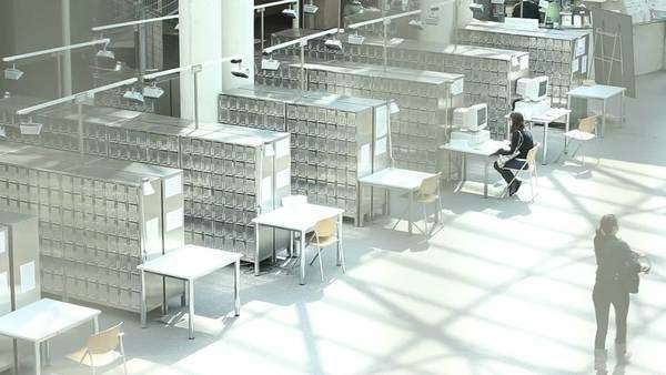 Students at work in a modern library. Royalty-free stock video