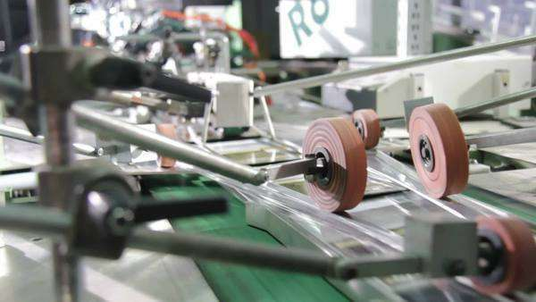 Automated production line producing packaged DVDs. Royalty-free stock video