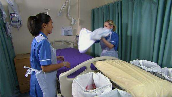 Female nurses changing hospital bed. Royalty-free stock video