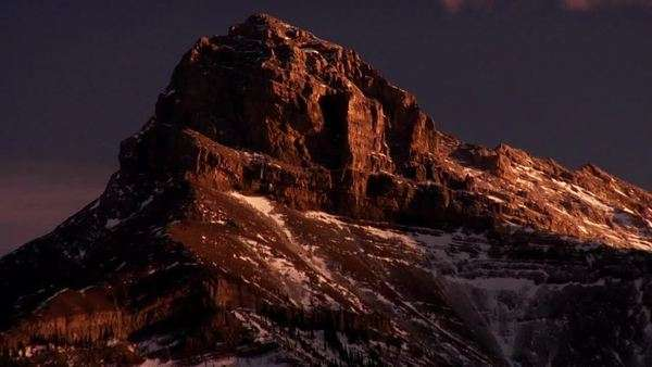 Timelapse of cloud shadows moving across the majestic Rocky Mountains Royalty-free stock video