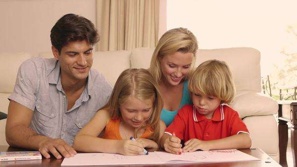 Family drawing and coloring together in living room. Royalty-free stock video